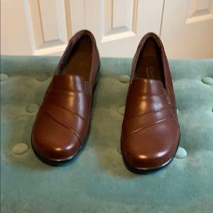 Clark's slip on dark brown— never been worn! :)